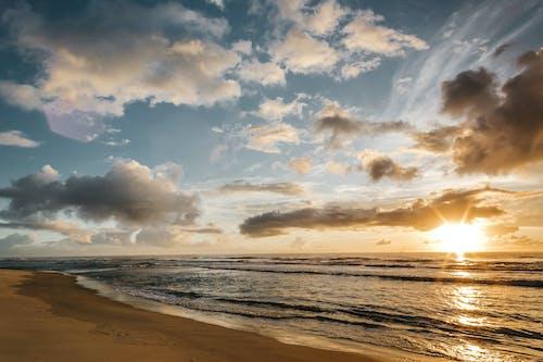 Golden sun above ocean waves