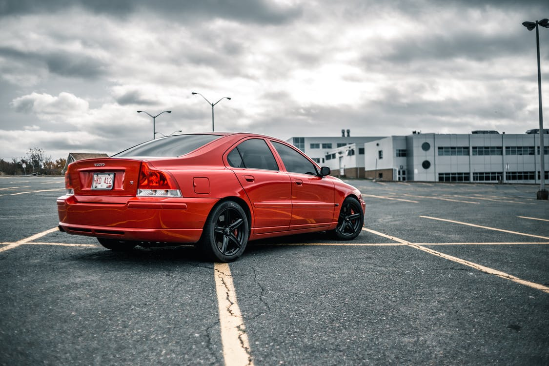 Red Volvo Parked on Parking Lot