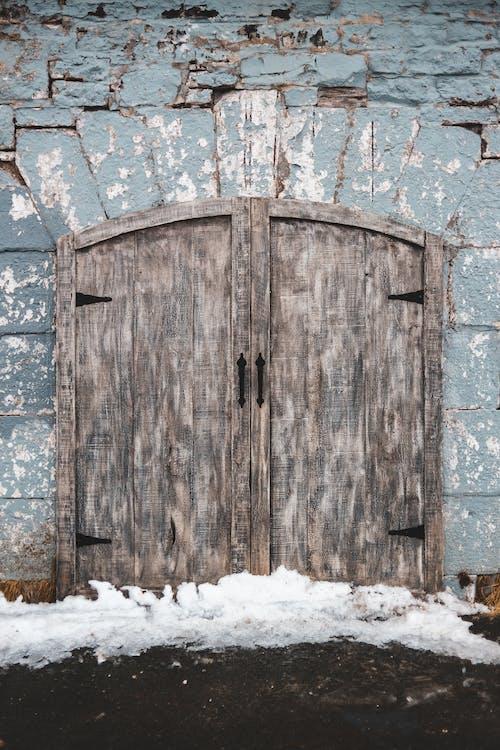 Brown Wooden Door on Snow Covered Ground