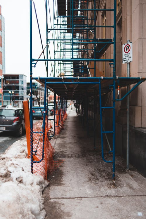Metal construction on city street during old building restoration