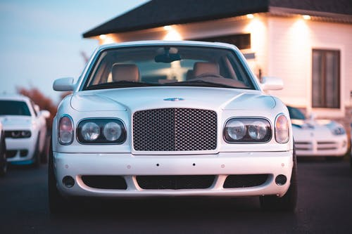 White Bentley Car in a Parking Lot