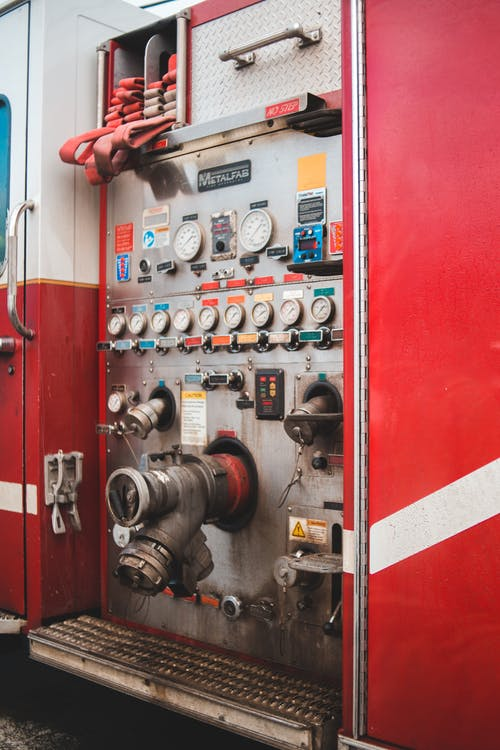 Bright fire truck compartment with tubes and measuring devices