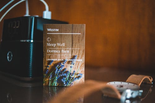 A Book Beside A Speaker On A Table