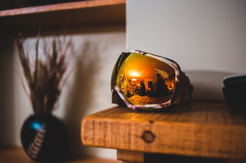 Goggles on Brown Wooden Table