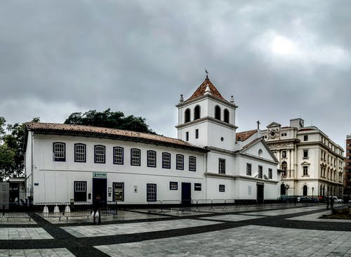 A Historical Building In A Plaza