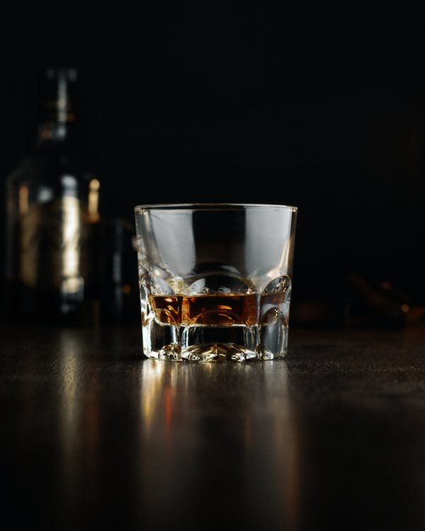 Clear Shot Glass With Brown Liquid Inside