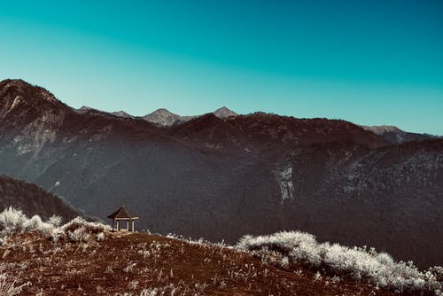 Gazebo Near Mountain Under Blue Sky
