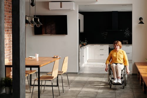 Woman Using Wheelchair at Home