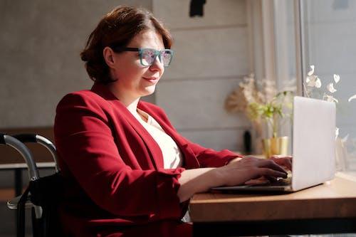 Woman in Red Blazer Wearing Eyeglasses