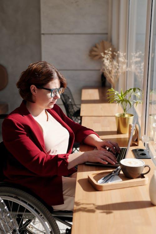 Woman in Red Blazer Wearing Eyeglasses Using Laptop Computer