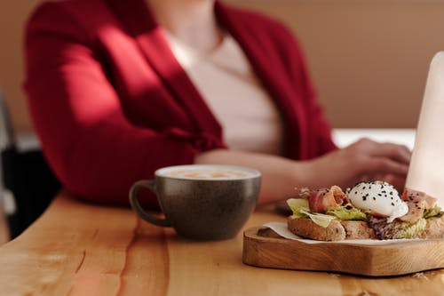 Close-Up Photo of Food and Coffee on Wooden Table