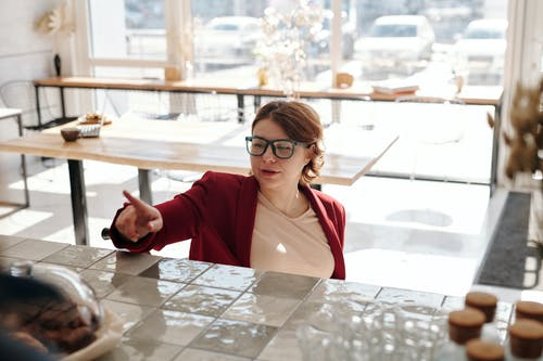 Woman in Red Blazer Wearing Black Framed Eyeglasses