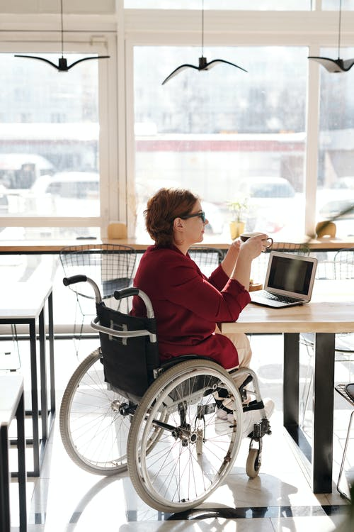 Woman in Red Blazer Sitting on Wheelchair