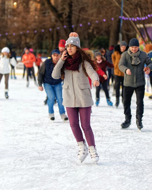 Woman Ice Skating in Rink