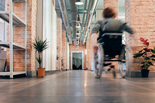Photo of Woman Moving Her Wheelchair