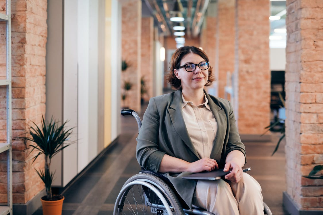 Woman Sitting on Black Wheelchair