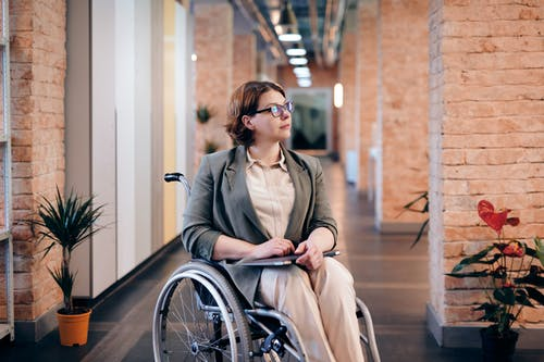 Photo of Woman Sitting on Wheelchair While Looking Away