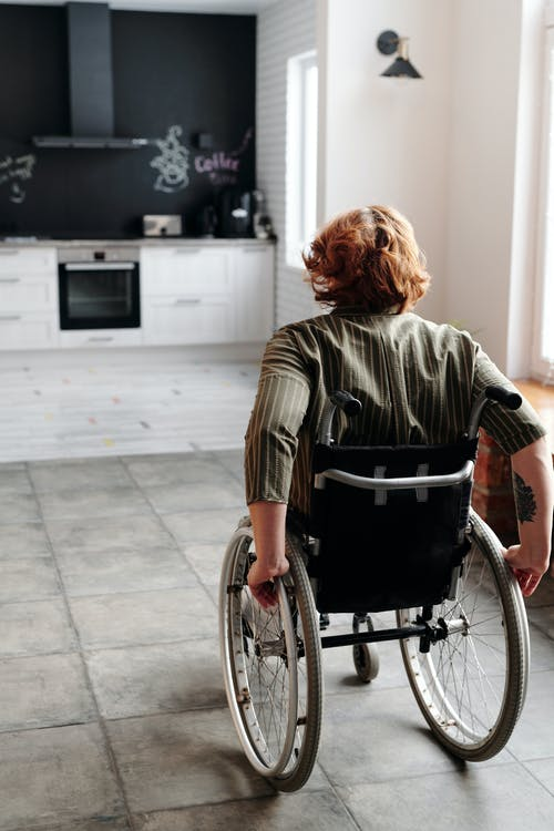 Woman Moving Using Wheelchair