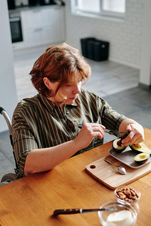 Woman Slicing an Avocado