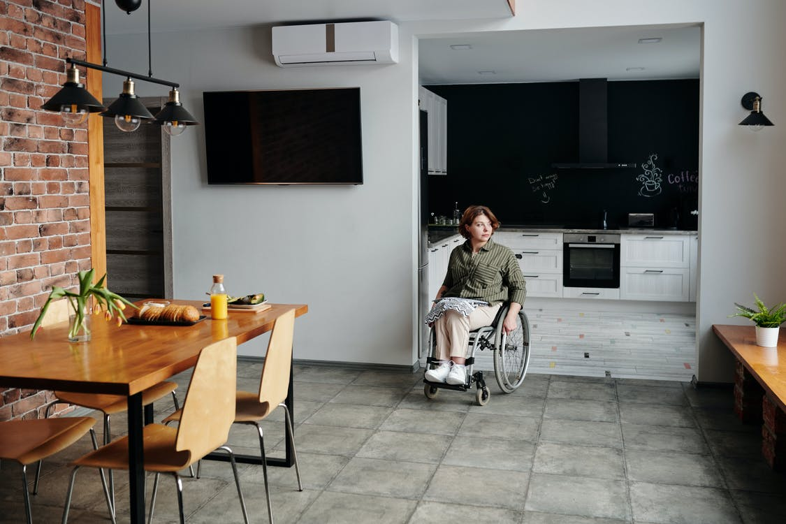 Woman Sitting on Wheelchair While Looking Away