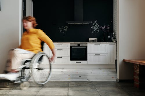 Woman Moving Using a Wheelchair