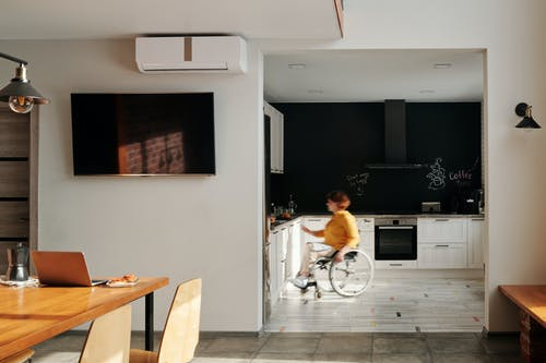 Woman in Wheelchair in Kitchen
