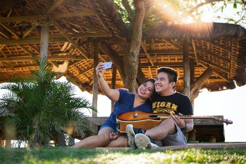 Couple Taking Photo Using Smartphone