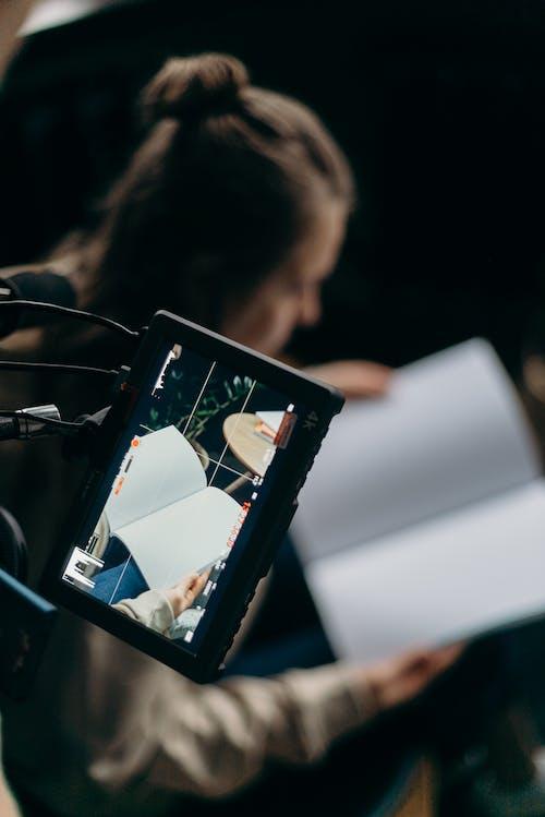 Girl Holding Black Tablet Computer