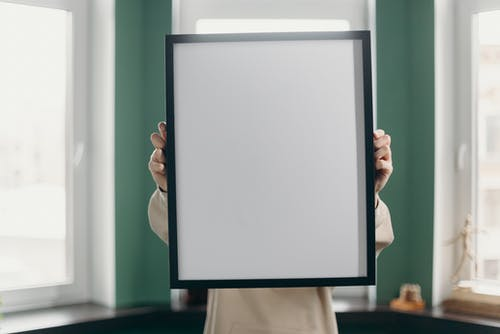 Person Holding White and Black Board