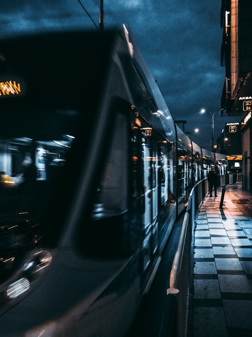 Black Train on Road during Night Time