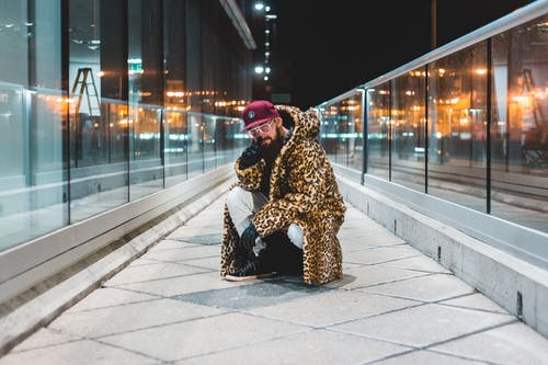 Photo Of Person Wearing Leopard Print Jacket