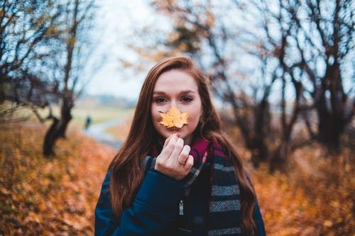 Photo Of Woman Holding Maple Leaf