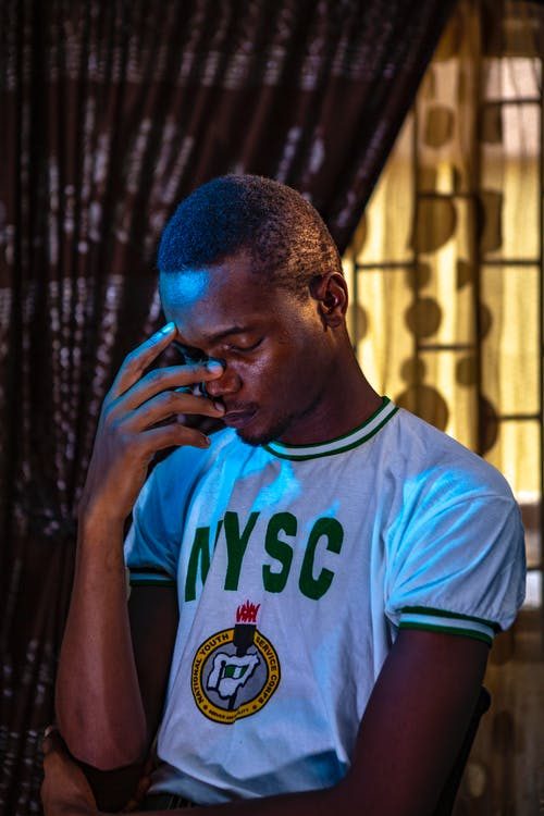 Man Wearing NYSC Shirt