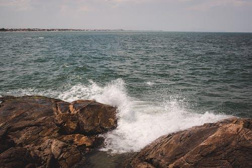 Photo Of Waves Crashing On Rocks