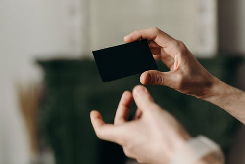 Person Holding Black Card