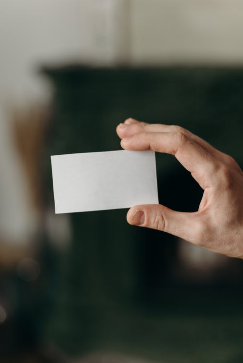 Person Holding White Blank Card