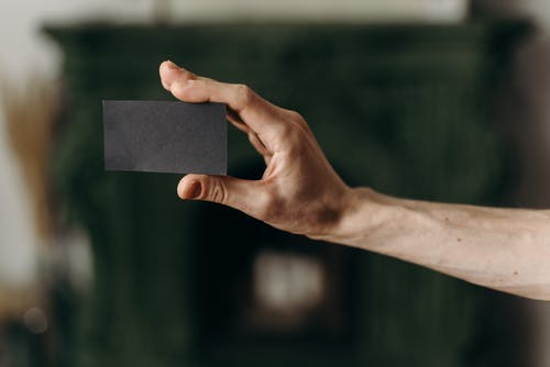 Person Holding Black Blank Card