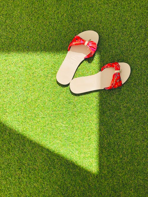 Red Flip Flops on Green Grass
