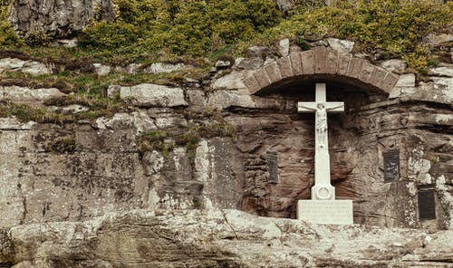 White Concrete Cross on Gray Rock Formation