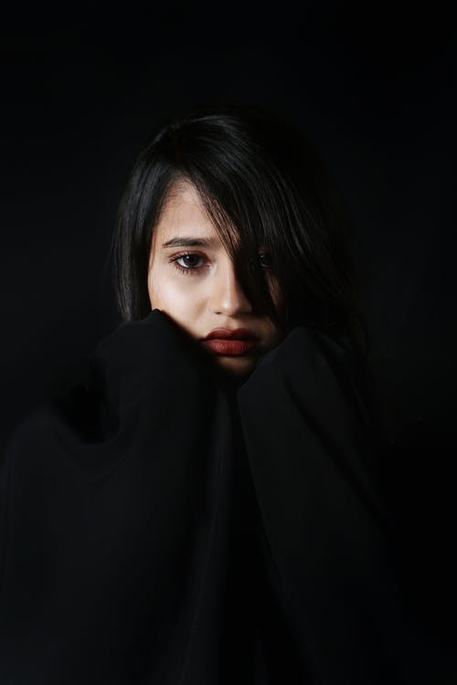 Woman Covering Her Face With Black Textile