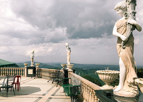 Ancient sculptures on observation deck with amazing mountain view