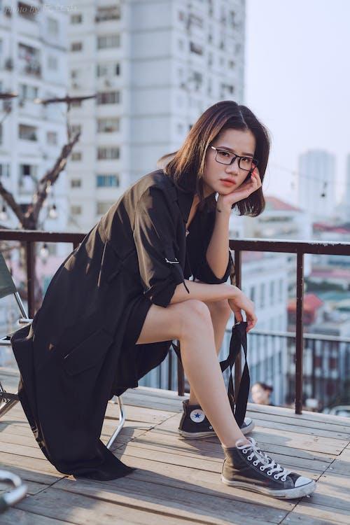 Photo Of Woman Wearing Black Cardigan