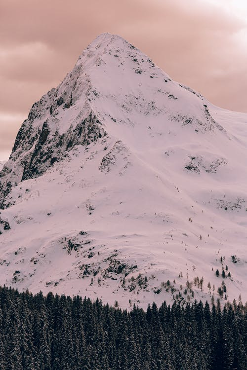 Photo Of Snow Covered Mountain During Dawn