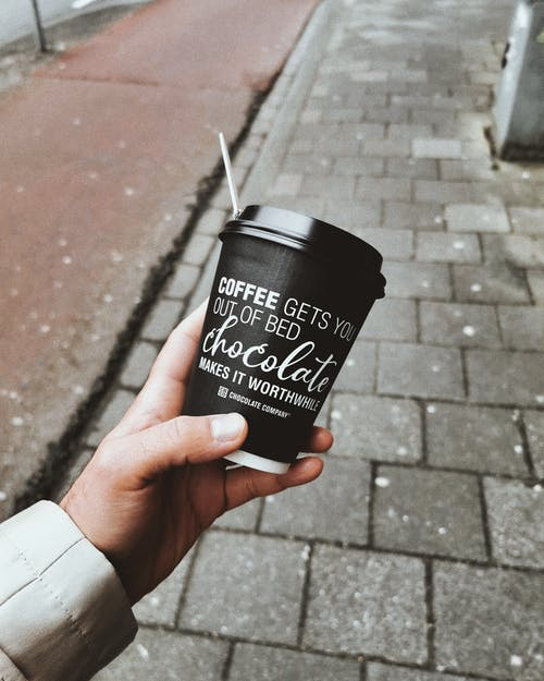 Photo Of Person Holding Disposable Cup