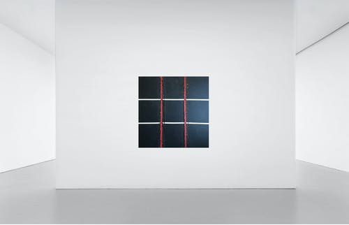 Black and Red Frames on White Wall