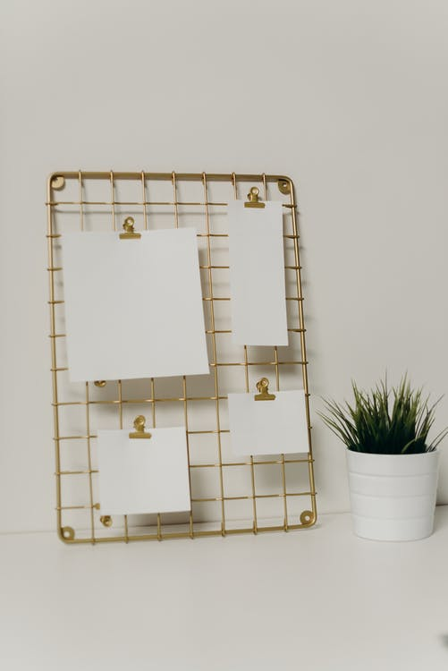White and Brown Floral Board