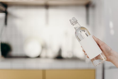 Clear Glass Bottle With White Cap