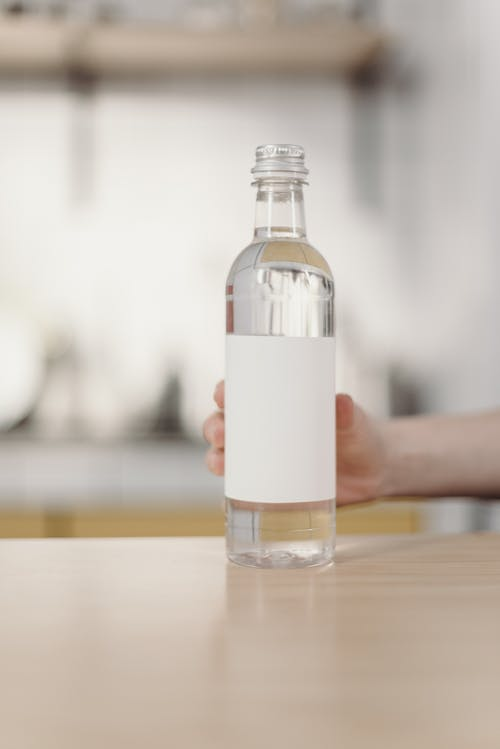 Photo Of Person Holding Bottle