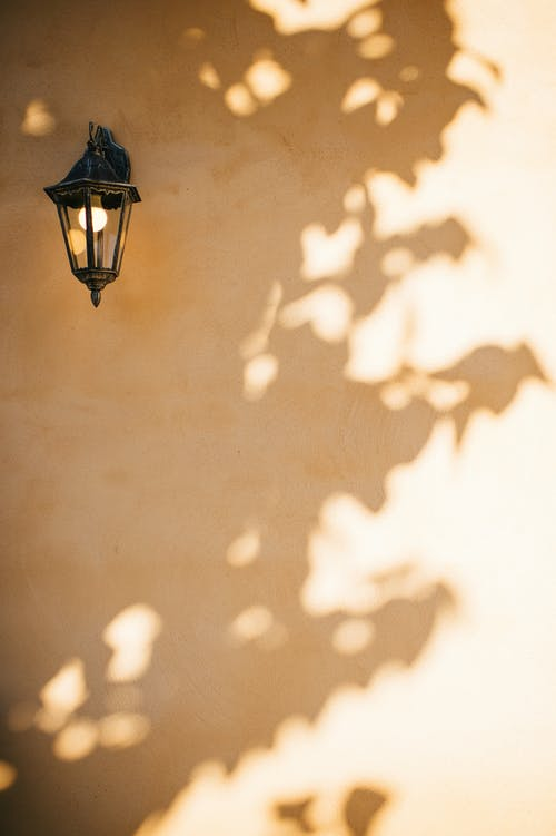 Black Sconce Lamp on Brown Wall