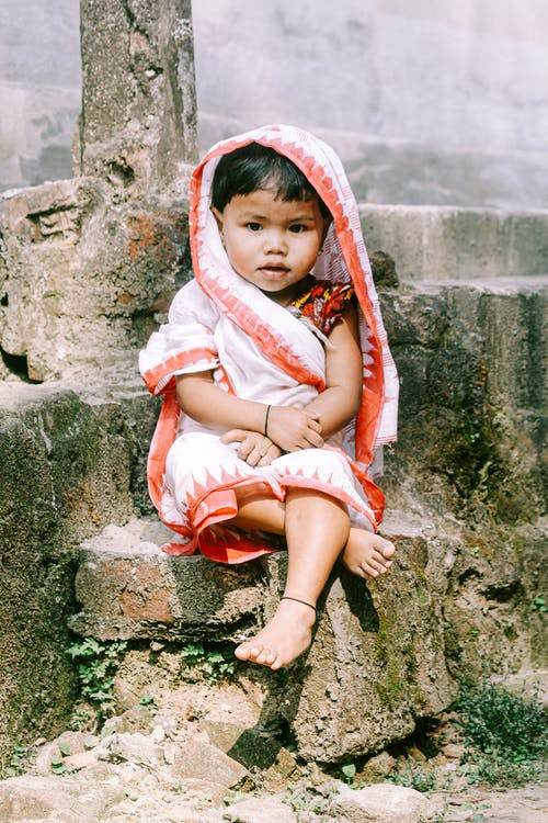 Photo Of Child Sitting On Stairs